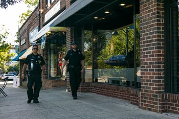 Two Chapel Hill police officers walk east on Franklin Street on Sunday, June 7, 2020.