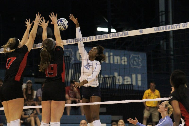 Middle hitter Sydnye Fields (10) jumps for a kill against Louisville in Carmichael Arena on Sunday.
