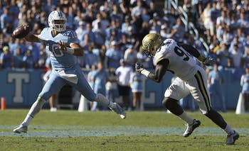 UNC quarterback Mitch Trubisky (10) throws a pass on the run against Georgia Tech on Saturday.