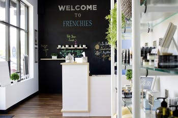 Customers get free rein over their Frenchies experience starting at the door. The scent wall allows you to pick your scent for sugar and scrub and looks over to the retail section, where Frenchies sells only all-natural products they use in-store. Photo by Melissa Fernandez.