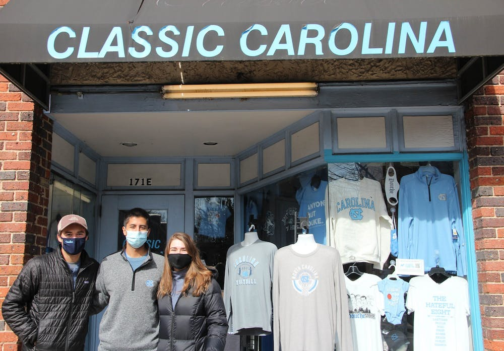 First-year Carson Moore, alumnus Kris Chellani, and senior and Launch Local co-founder Nikita Billman stand outside of Classic Carolina on Jan. 30 2021. Classic Carolina is one of Launch Local's clients.