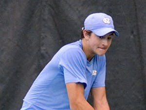 2-9 UNC vs TCU - UNC player Brayden Schnur returns Nick Chappell's (TCU) serve. Brayden finished the match with a 6-1, 3-6, 6-3 victory after breaking his opponent late in the third set.