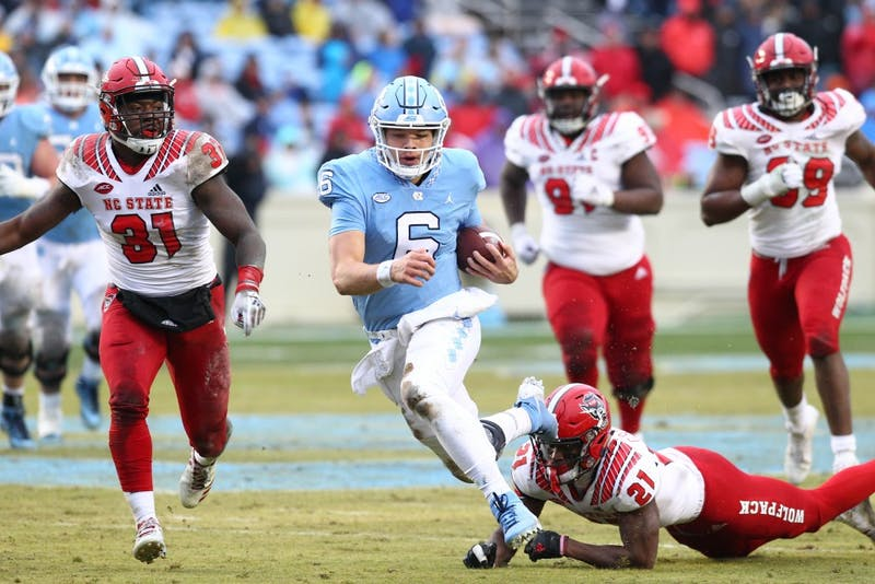 UNC quarterback Cade Fortin (6) runs in the open field in UNC's game against N.C. State on Saturday in Kenan Memorial Stadium.