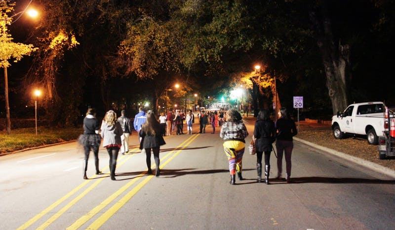 Students walk along Franklin Street towards the large crowd.