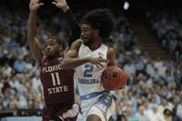 First-year guard Coby White (2) drives the ball during UNC's 77-59 win over FSU at the Smith Center on Saturday, Feb. 23, 2019.