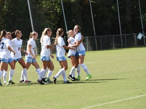 The North Carolina women's soccer team celebrates during a win over Syracuse on Sep. 30 at WakeMed Soccer Park in Cary.