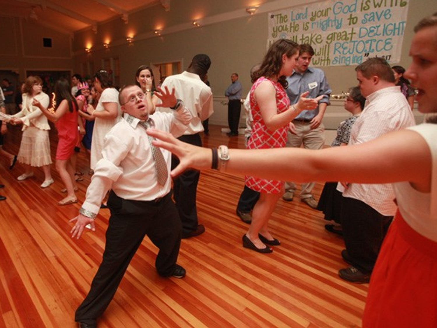 Matthew LaPerre, 21, of Durham, dances with his friend Sally Turner.
