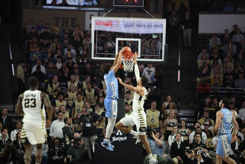 Graduate guard Cam Johnson (13) dunks in No. 8 UNC's 95-57 win over Wake Forest on Saturday, Feb. 16, 2019 at Lawrence Joel Veterans Memorial Coliseum. Johnson scored 27 points for the Tar Heels.