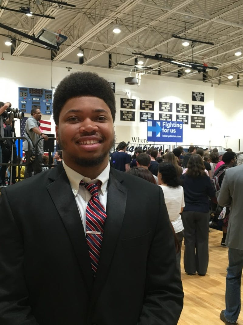 Hillside Senior Jalen McGee poses before Hillary Clinton takes the stage.