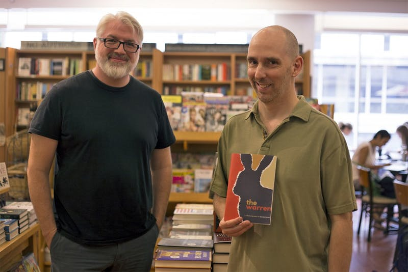 Steve Segedy (left) and Jason Morningstar, application analysts at UNC, stand in Bullhead's Bookshop with some of the books they have written. The two have recently developed Warren, a role-playing game based on the classic novel Watership Down.