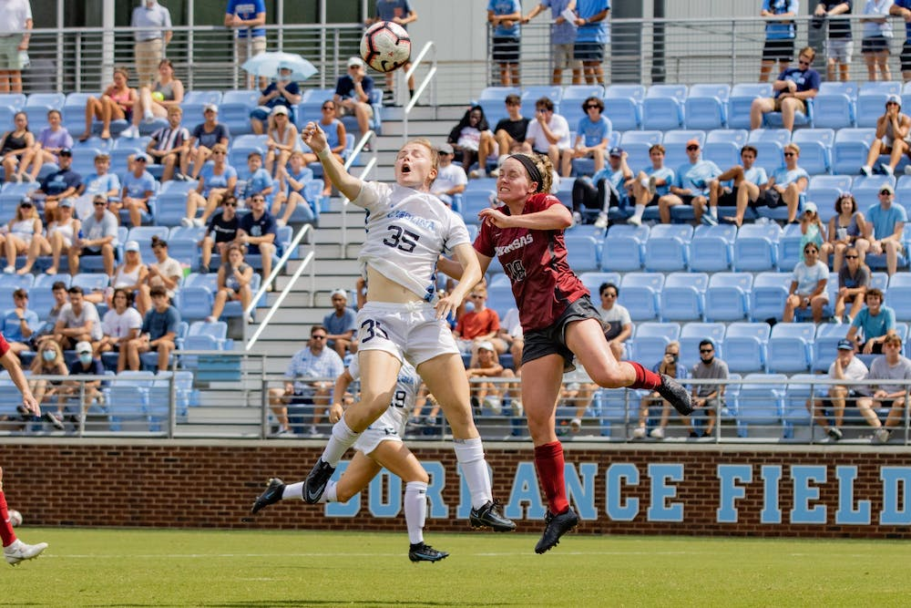 <p>UNC First-Year Forward Emily Murphy (35) delivers a header during the Tar Heels' game against the Arkansas Razorbacks at Dorrance Field on Sunday, Aug. 22.</p>
