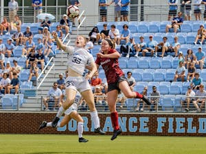 UNC First-Year Forward Emily Murphy (35) delivers a header during the Tar Heels' game against the Arkansas Razorbacks at Dorrance Field on Sunday, Aug. 22.