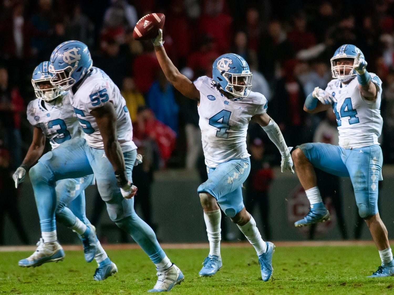 Players celebrate sophomore defensive back Trey Morrison's (4) interception during a game against NC State University on Saturday, Nov. 30, 2019.