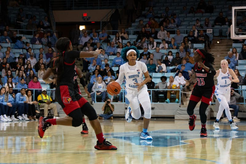 Senior redshirt guard Madinah Muhammad (3) dribbles the ball in the game against Louisville at Carmichael Arena on Sunday, Jan. 19, 2020. UNC lost 67-74.