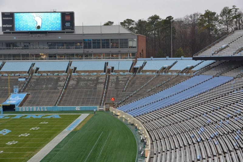 After experimenting with individual seating in sections 110 and 111 (in blue on the right side), UNC is renovating Kenan Stadium and adding individual seats throughout.
