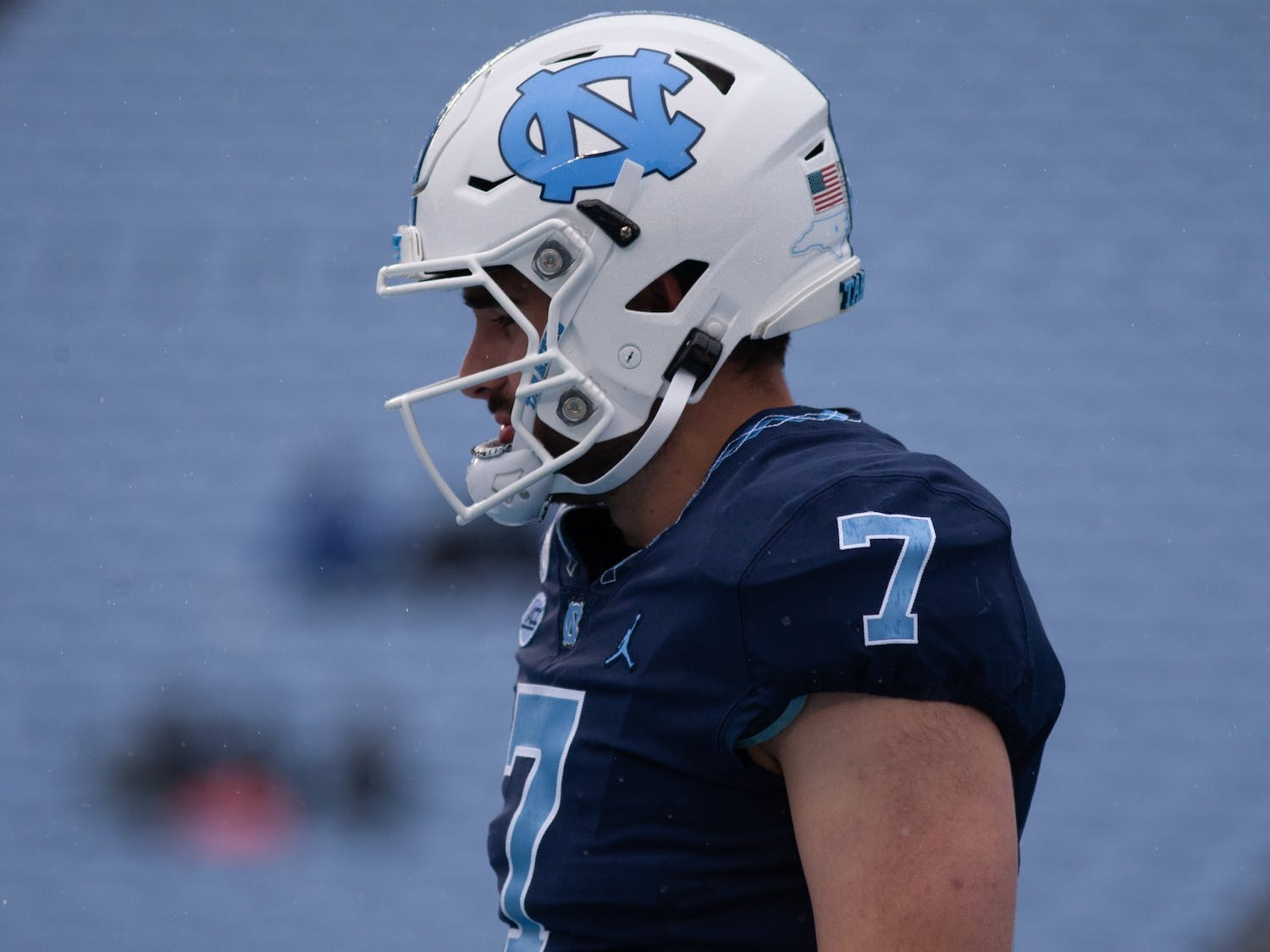 UNC junior quarterback Sam Howell (7) waits for his turn in a drill during Carolina's rainy spring game on April 24th in Kenan Stadium.