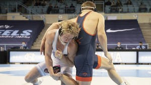Clay Lautt wrestles against UVA's Vic Marcelli in the 174 lbs weight division in Carmichael Arena on Feb. 13, 2021. Lautt won his match and UNC won overall, 25-9.