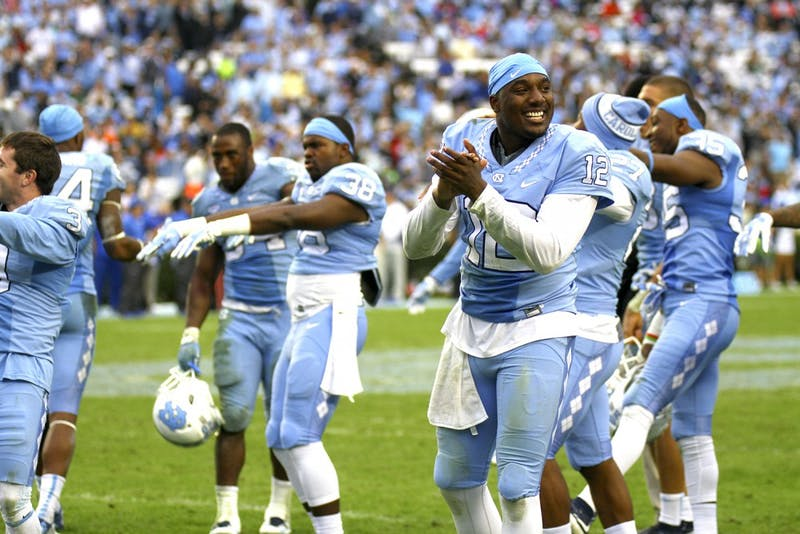 Marquise Williams (12) and teammates celebrate a lead against Duke on Nov. 7 at Kenan Stadium.