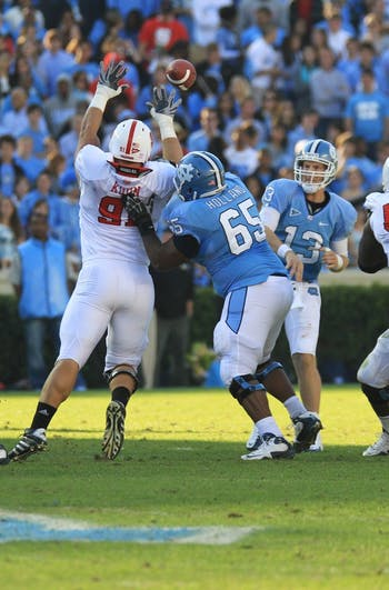 T.J. Yates set UNC records in both single-season and career-passing marks. Yates finished Saturday's game with 411 yards and two touchdowns.