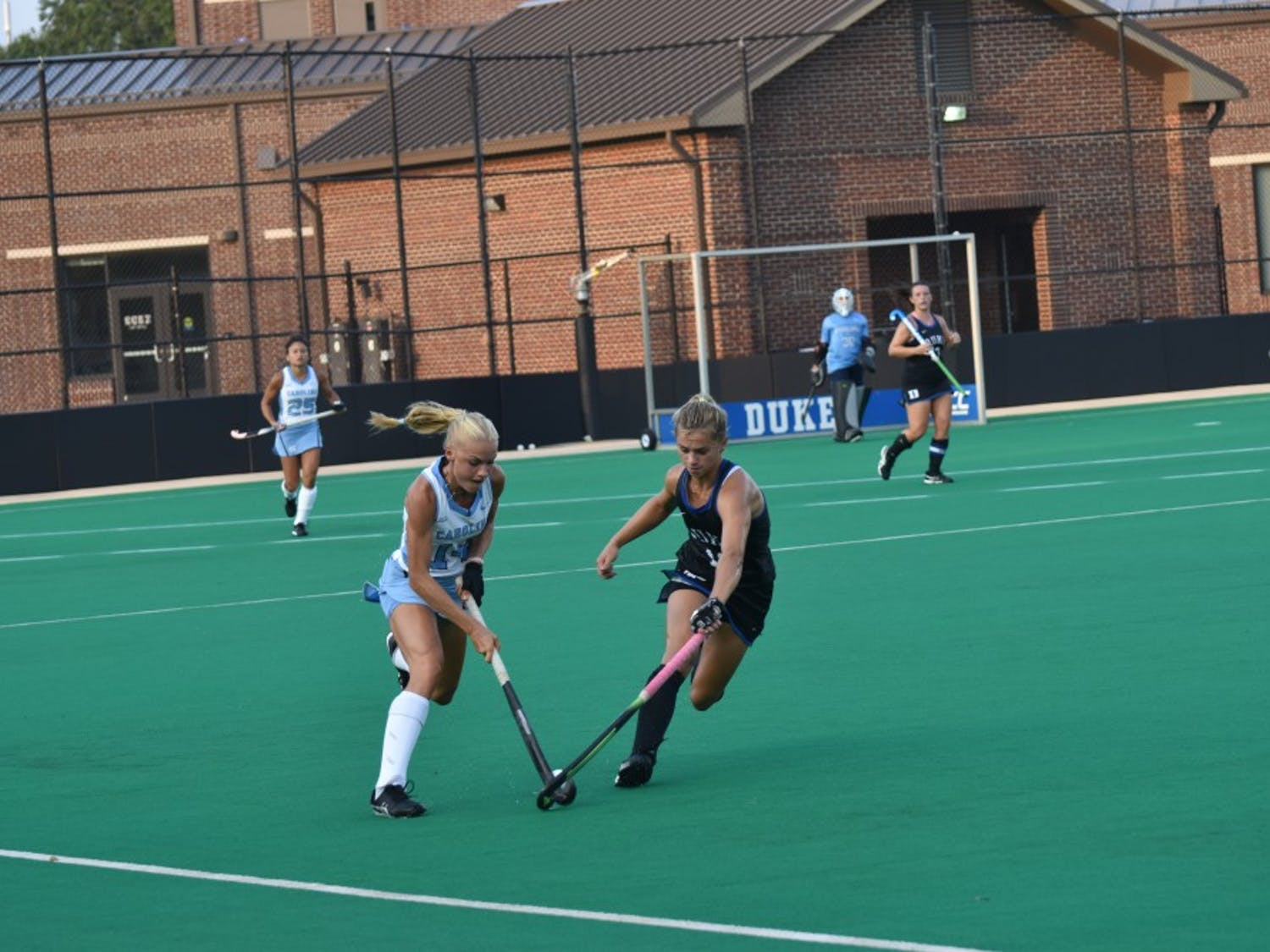 Midfielders Feline Guenther (14) and Margaux Paolino (12) compete for the ball on Friday, Sept. 21, 2018 on Williams Field at Jack Katz Stadium.