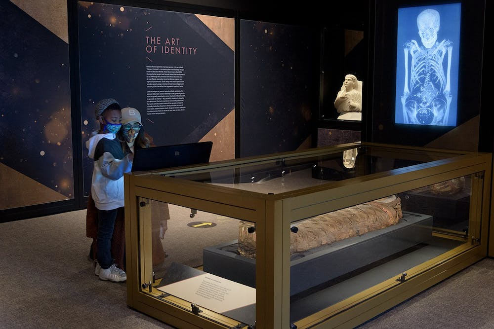 <p>Visitors at the North Carolina Museum of Art explore the Golden Mummies of Egypt exhibit. Photo courtesy of the NCMA.</p>
