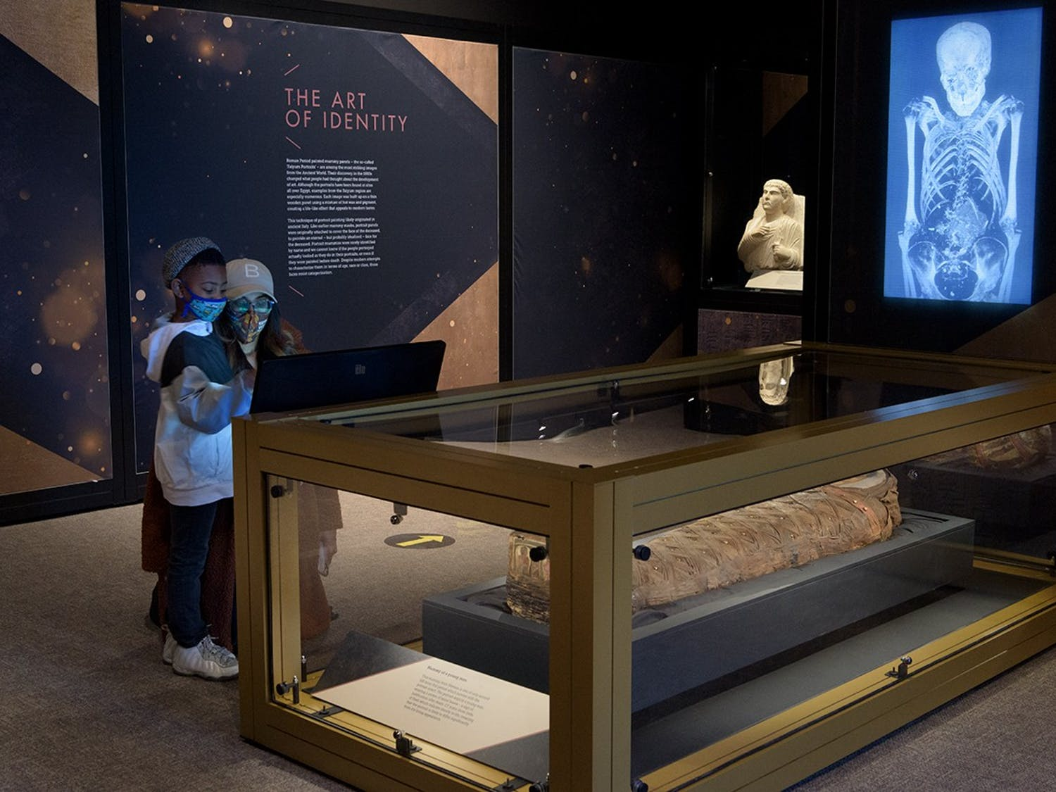 Visitors at the North Carolina Museum of Art explore the Golden Mummies of Egypt exhibit. Photo courtesy of the NCMA.