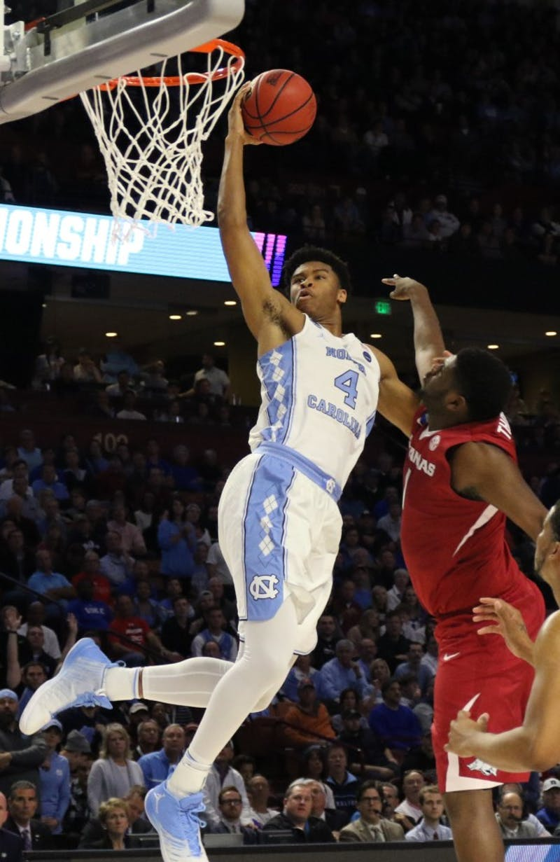 North Carolina forward Isaiah Hicks (4) goes up for a lay in against Arkansas in the second round of the NCAA Tournament in Greenville on Sunday.