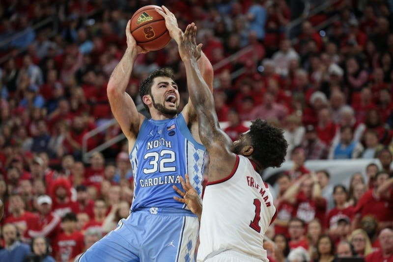 North Carolina forward Luke Maye (32) takes a layup over N.C. State forward Lennard Freeman (1) on Feb. 10 in Raleigh.