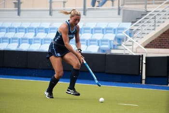 Back Ellen Payne (35) prepares to hit the ball on Sunday Sept. 15, 2019. UNC's field hockey team won 8-0 against William and Mary.