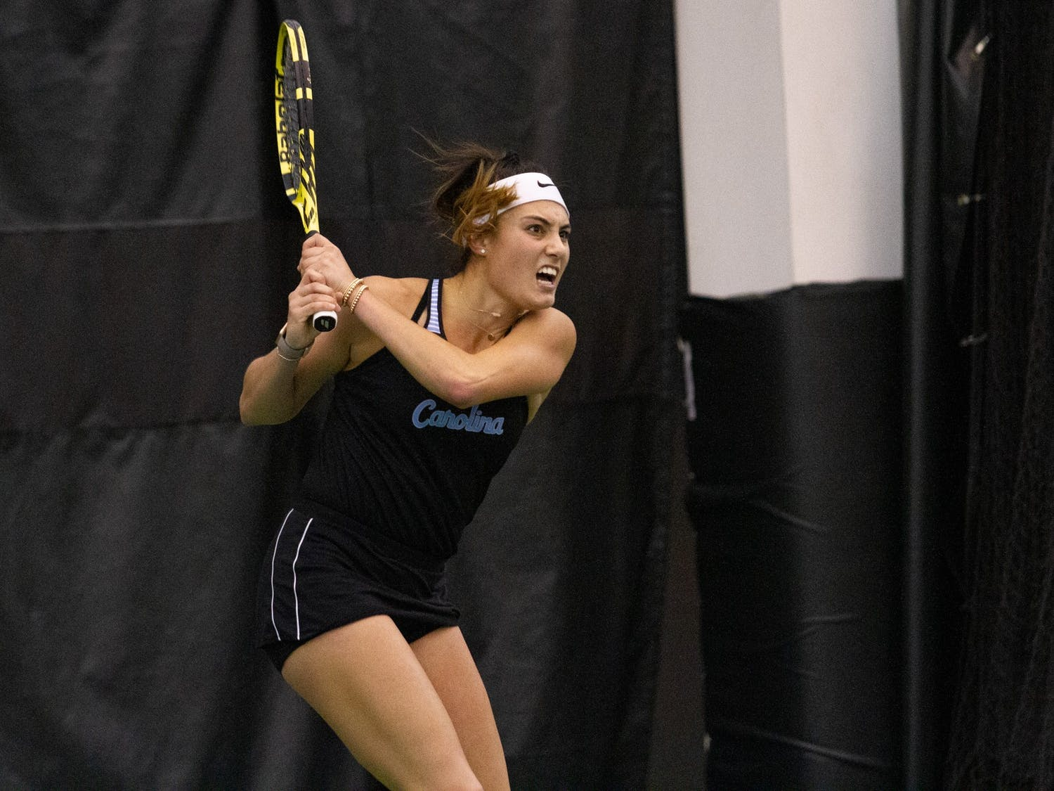 UNC senior Alexa Graham after returning a volley during her singles match against Old Dominion University during the ITA Championship hosted at the Cone-Kenfield Tennis Center in Chapel Hill, NC, on Saturday, January 25th. Following her wins over the course of the championship, Graham moves into fifth place in the programs overall wins list with 121 career wins. The Tar Heels went on to win the championship  4-1 against Old Dominion University.