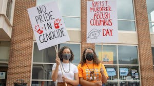 First-year psychology major Cheyanne Jacobs and first-year biology major Laurel Emanuel are members of the Carolina Indian Circle. The two hold signs in the Pit on Oct. 11, Indigenous Peoples' Day. This year, University leadership and the American Indian Center issued a proclamation to recognize the day for the first time.