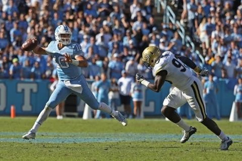 UNC quarterback Mitch Trubisky (10) attempts a pass under pressurein a 48-20 win over Georgia Tech on Nov. 5. Trubisky will forgo his senior season andenter the 2017 NFL Draft.