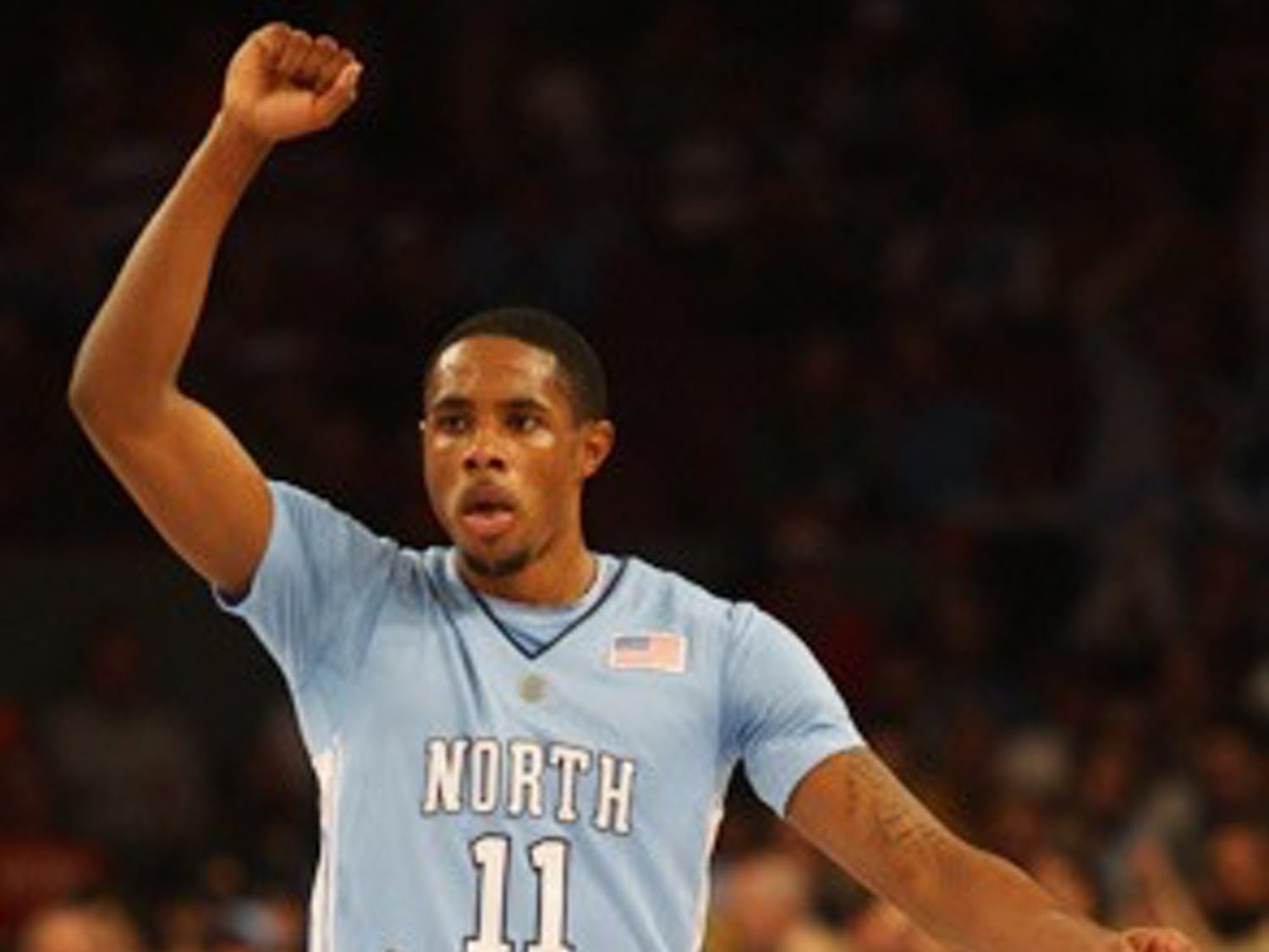 Larry Drew II directs UNC's defense during No. 4 North Carolina's 77-73 win against No. 15 Ohio State. DTH/Andrew Johnson
