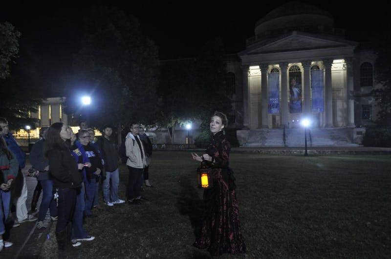 Sarah George-Waterfield leads Thrills 'n Chills tour around UNC campus Thursday night.