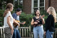 (From left to right) Hailey Haymond, Anna Sharpe, Kate Aberman and Caroline Porter, members of the Carolina Ukelele Ensemble, give an impromptu performance in Polk Place on Tuesday, Oct. 9, 2018.