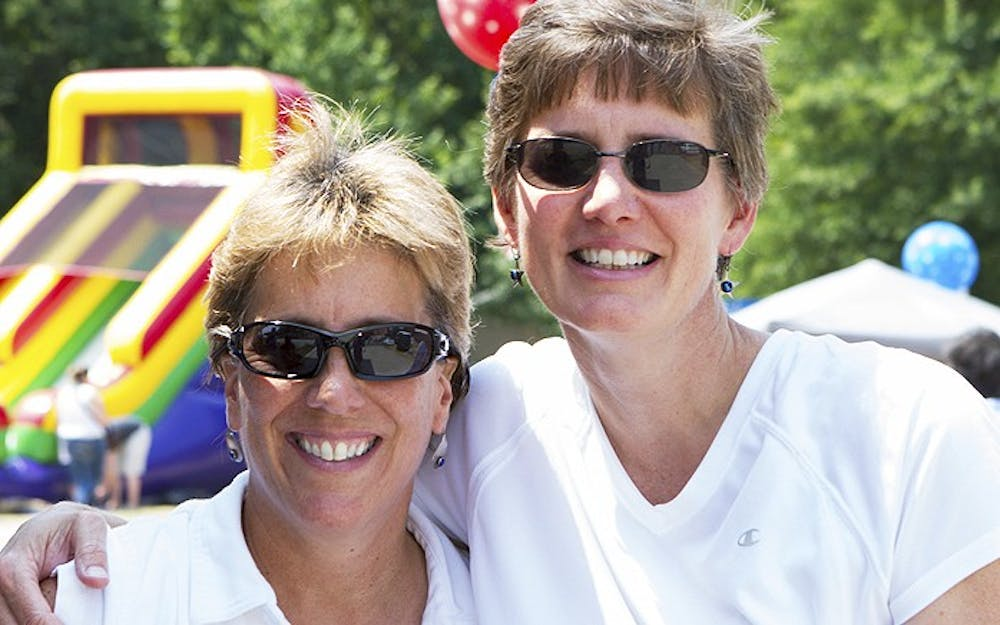 <p>Alicia Stemper, right, and Lydia Lavelle became domestic partners in 2011. Photo courtesy of Avery Stemper.</p>