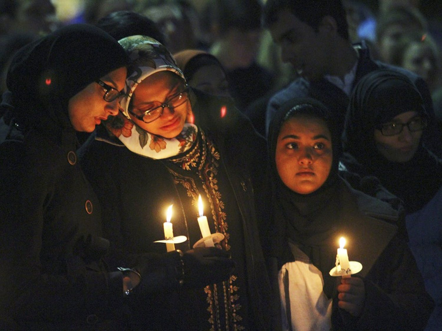 Mourners hold candles at a vigil in the Pit for Deah Shaddy Barakat, Yusor Mohammad Abu-Salha and Razan Mohammad Abu-Salha on Feb. 11. Thousands gathered to mourn their loss.