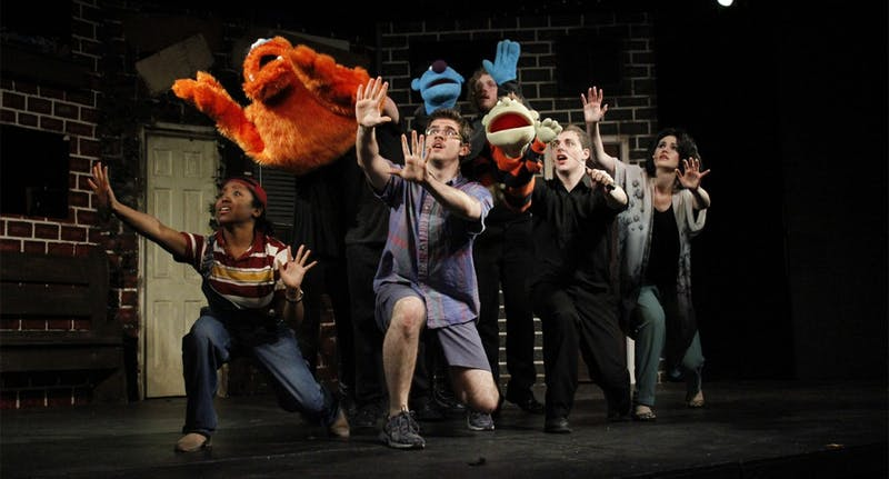 Student performers act out a musical scene during a dress rehearsal for Pauper Player's production of Avenue Q. The rehearsal took place at the Arts Center in Carrboro, Wednesday the 2nd of April.
