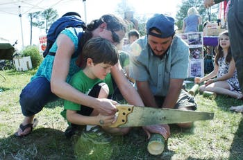 """Earth Action Day Festival was celebrated at Southern Community Park on Saturday to raise awareness about ways to be sustainable in everyday life. Josh Conklins is helped by his mother Brooke to create a bamboo bowl. """"I heard about this festival through the Southern Village E-newsletter,"""" says Brooke."""