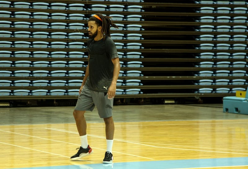 Rapper J. Cole shoots around during the UNC Men's Basketball Media Day in the Dean Smith Center on Wednesday, Oct. 2, 2019.