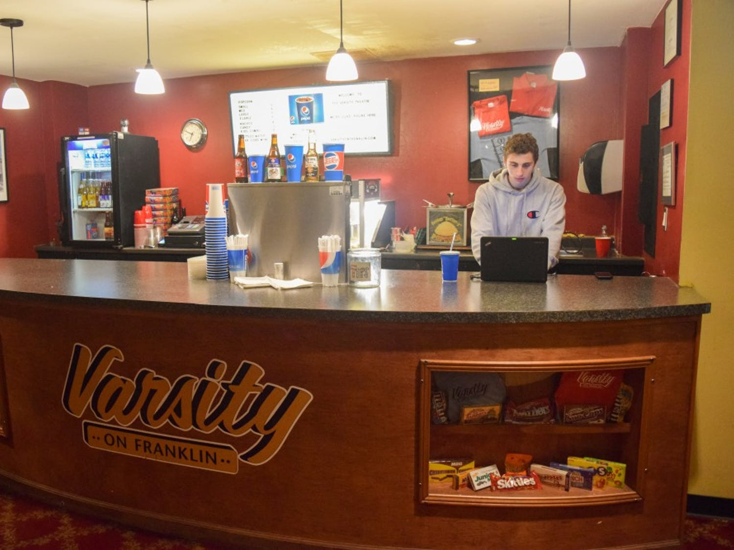 Jack Shareshian, a Chapel Hi;; High School Senior, runs the concession stand at the Varsity Theater on Franklin. The Varsity Theater Task force is looking to use the historic building as a space for performing arts.