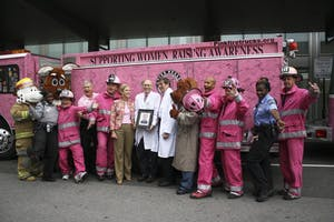 Chapel Hill firefighters, police officers, and doctors gathered in front of one of the pink fire trucks before the National Pink Heals Tour parade.