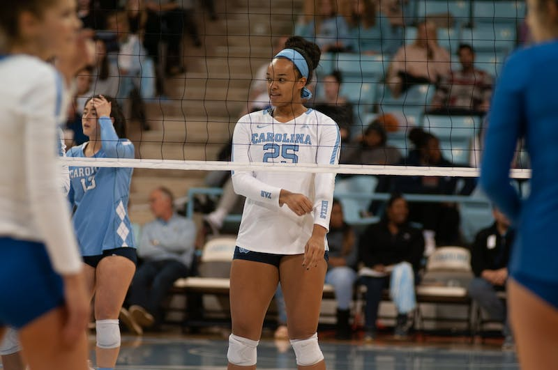 Redshirt first-year Lauren Harrison anticipates a serve in UNC Volleyball's 3-0 win over Duke Thursday.