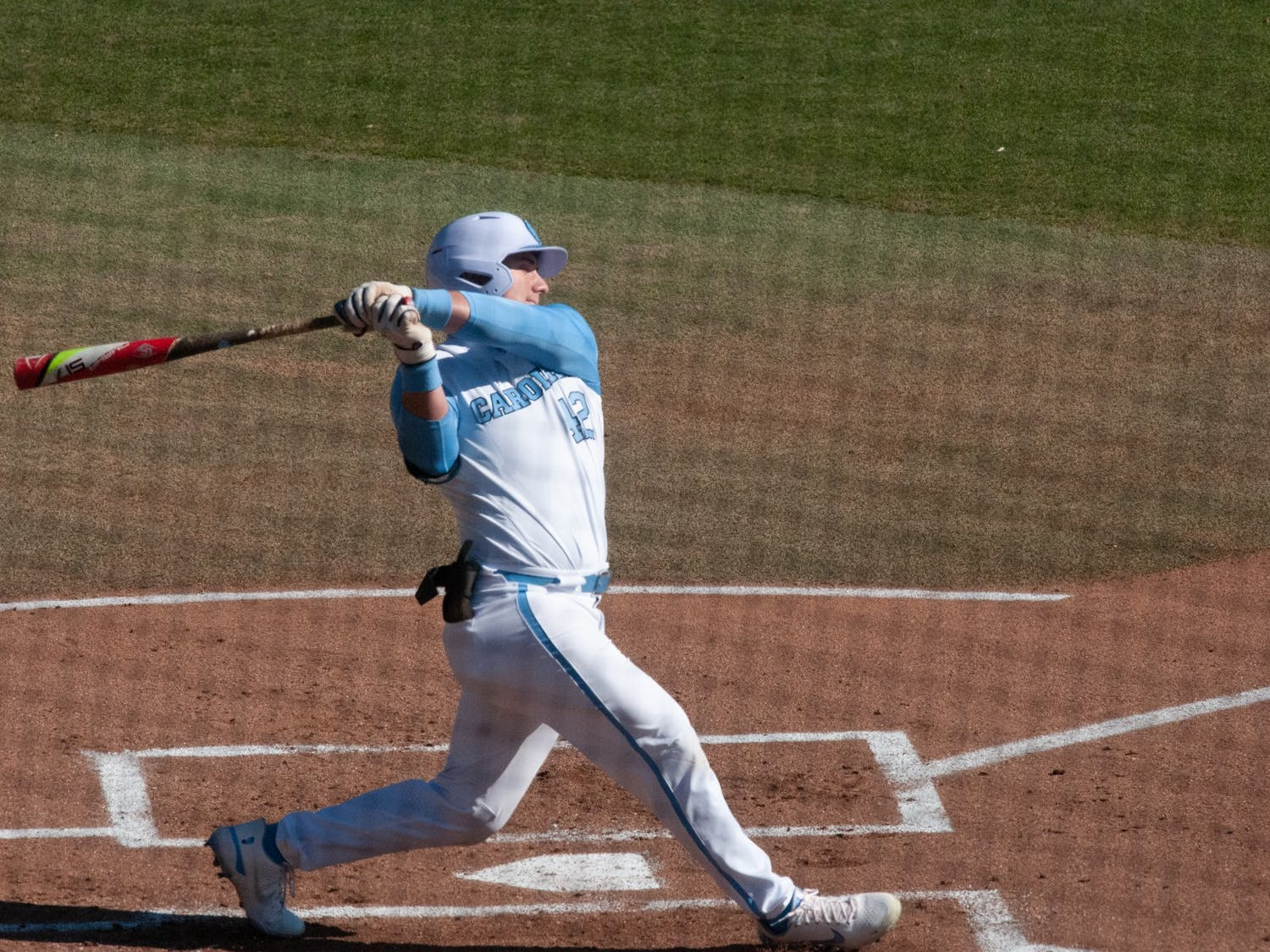 UNC first-year outfielder Will Stewart (12) swings at a pitch during UNC's 7-4 win over James Madison at Boshamer Stadium, Feb. 20, 2021.