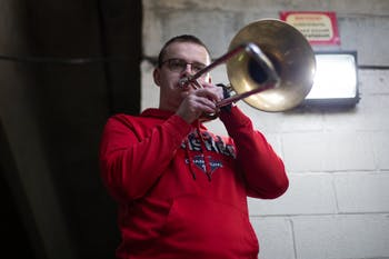Christian Boletchek, a senior music major, practices his trombone in a parking deck on Rosemary St. on Saturday, Oct. 31, 2020.