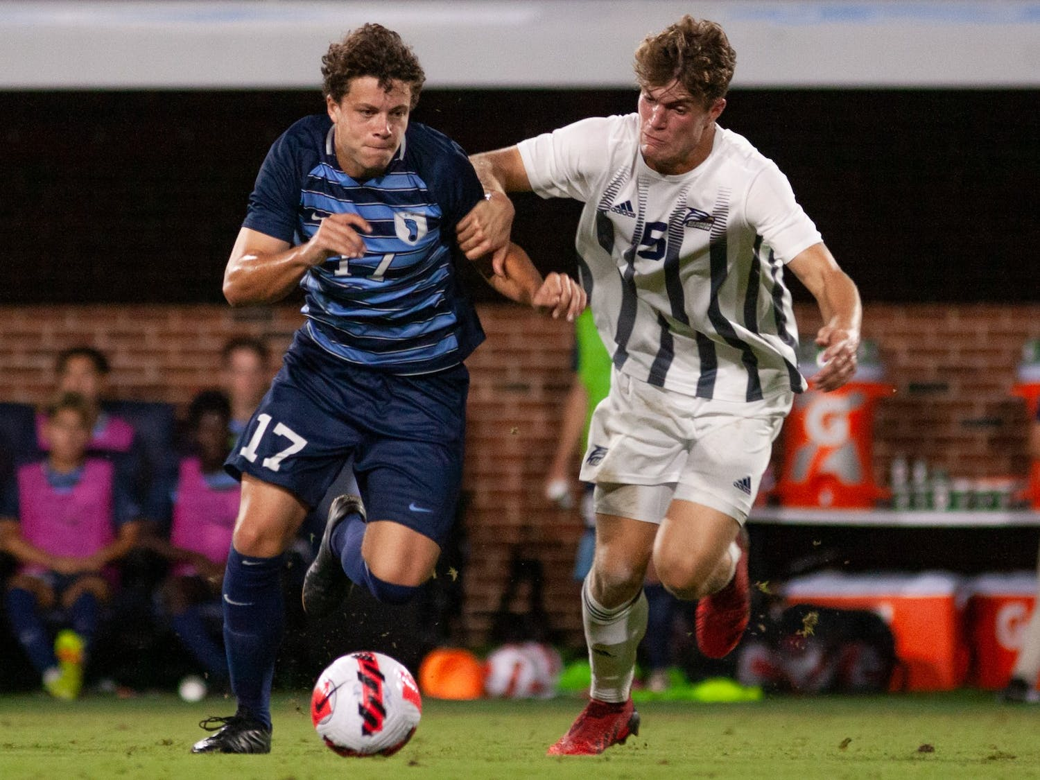UNC junior midfielder Cameron Fisher (17) struggles for posession of the ball during the UNC v. Georgia Southern game at Dorrance Field on Sep. 3.