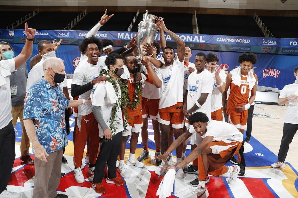 Texas' basketball team celebrates their win over UNC in the championship game of the Maui Invitational Tournament on Wednesday, Dec. 2, 2020 in Asheville N.C. Photo courtesy of Brian Spurlock/Camping World Maui Invitational.