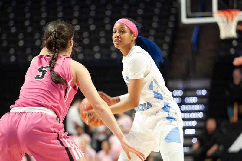 UNC red shirt senior guard Madinah Muhammad (3) keeps the ball from Wake Forest junior guard Gina Conti (5) at the Lawrence Joel Veterans Memorial Coliseum in Winston-Salem on Sunday, Feb. 23, 2020. The Tar Heels lost against the Demon Deacons 79-82.