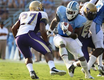 UNC tight end Ryan Houston (32) runs the ball in the game against James Madison on Saturday. UNC defeated JMU 42-10.