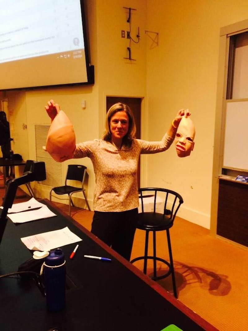 Professor Rita Balaban stands with the two masks she removed from streakers who interrupted her class on Thursday.